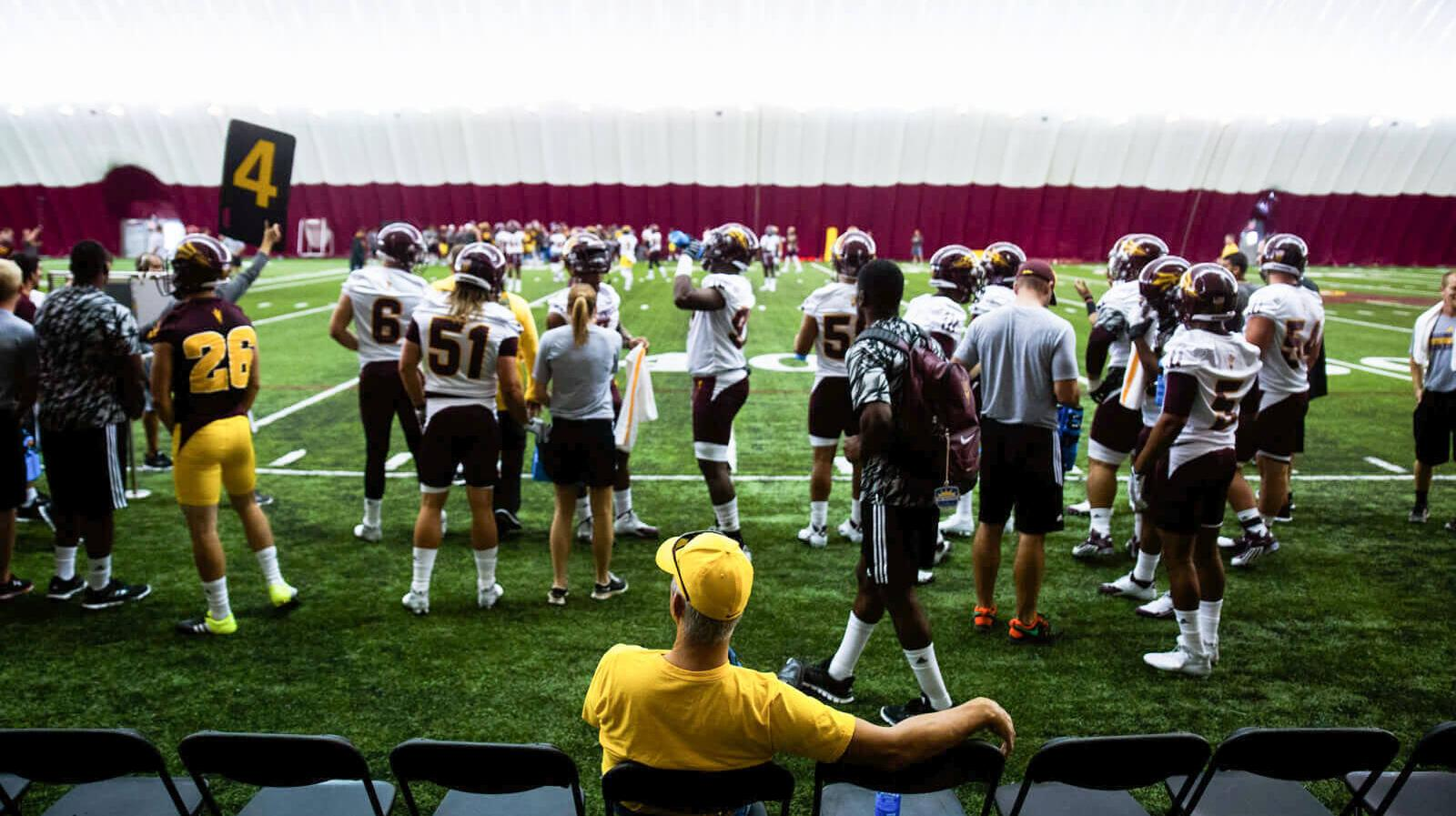 "Student football players practice in the ""Dickey dome"""